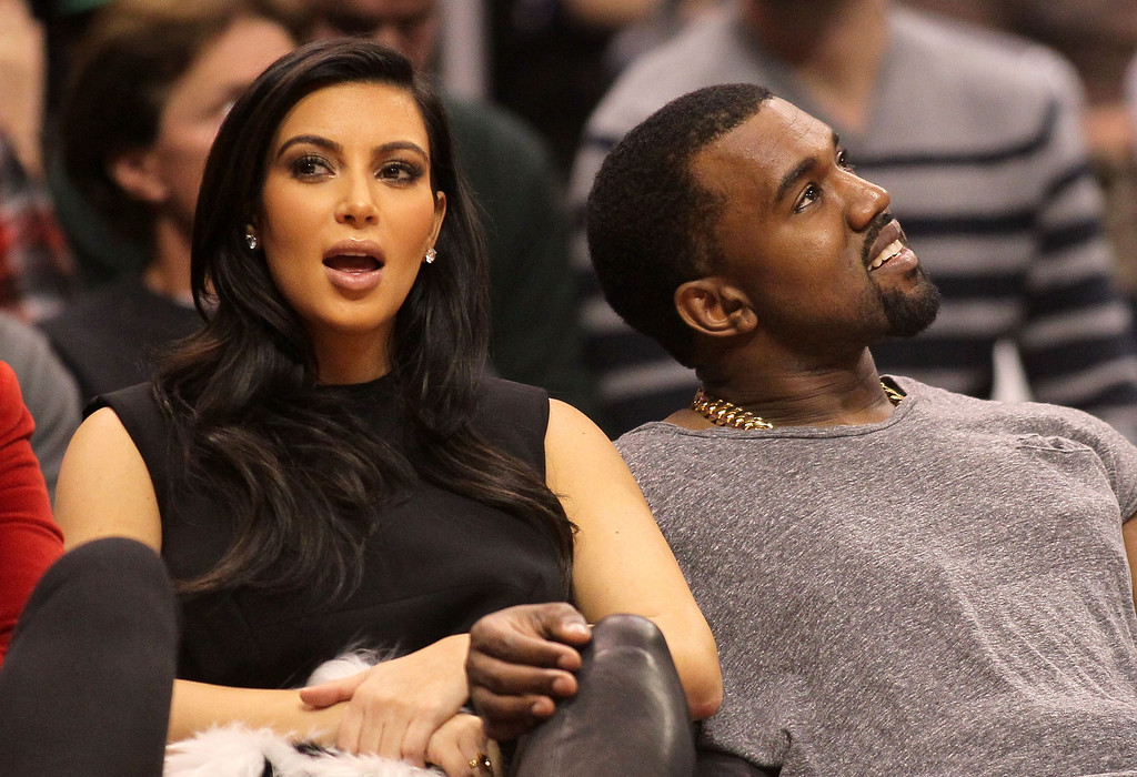 . LOS ANGELES, CA - DECEMBER 25:  Kim Kardashian and Kanye West attend the NBA game between the Denver Nuggets and the Los Angeles Clippers at Staples Center on December 25, 2012 in Los Angeles, California. The Clippers defeated the Nuggets 112-100. NOTE TO USER: User expressly acknowledges and agrees that, by downloading and or using this photograph, User is consenting to the terms and conditions of the Getty Images License Agreement.  (Photo by Victor Decolongon/Getty Images)