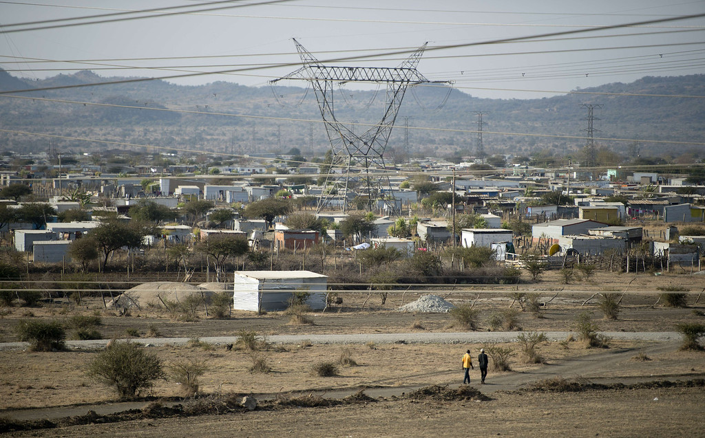 . A general view taken on July 9, 2013 shows the Nkaneng shantytown next to the platinum mine, run by British company Lonmin, in Marikana. On August 16, 2012, police at the Marikana mine open fire on striking workers, killing 34 and injuring 78, during a strike was for better wages and living conditions. Miners still live in dire conditions despite a small wage increase.  ODD ANDERSEN/AFP/Getty Images