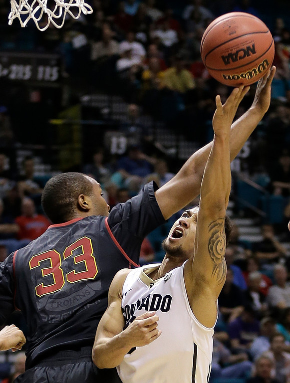 . Colorado\'s Askia Booker, right, shoots against Southern California\'s D.J. Haley in the first half of an NCAA college basketball game in the Pac-12 men\'s tournament, Wednesday, March 12, 2014, in Las Vegas. (AP Photo/Julie Jacobson)