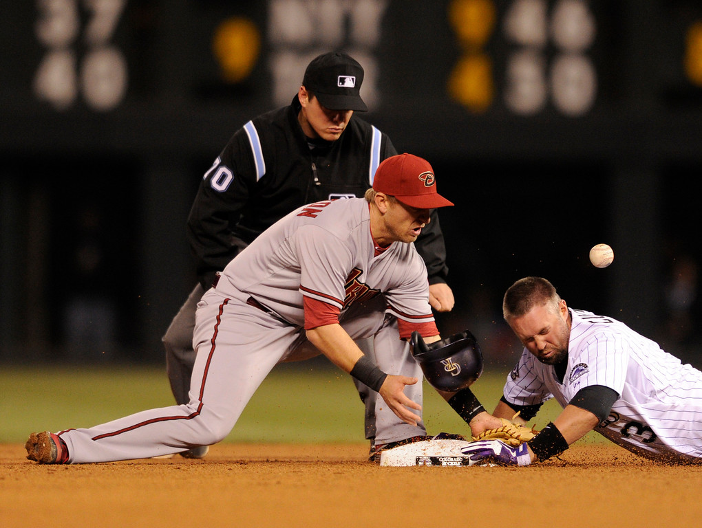 . DENVER, CO. - APRIL 19:  Michael Cuddyer slid safely into second  base as Arizona 2B mishandled the throw in the fourth inning. The Colorado rockies hosted the Arizona Diamondbacks at Coors Field Friday night, April 19, 2013.  Photo By Karl Gehring/The Denver Post)