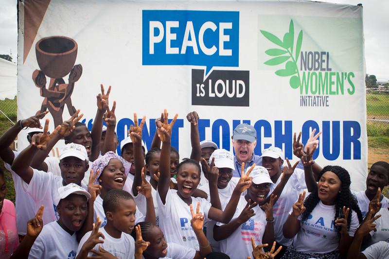 Monrovia Liberia October 5, 2017 - Jordan Ryan joins women at the prayer tent to emphasize peace is loud.