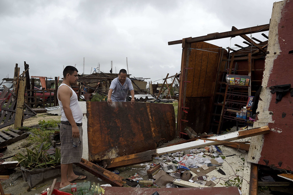 . People look at the destruction caused by hurricane Odile in Cabo San Lucas, in Mexico\'s Baja California peninsula, on September 15, 2014.  AFP PHOTO/RONALDO SCHEMIDT/AFP/Getty Images