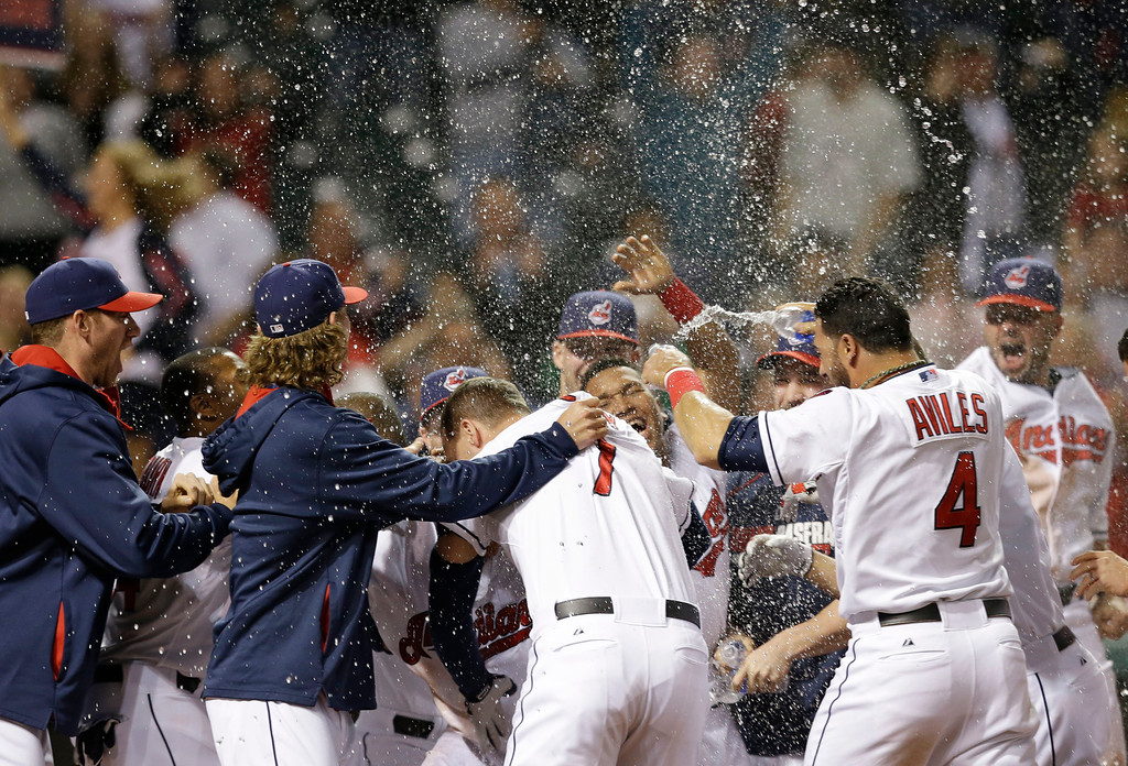 . The Cleveland Indians celebrate after Michael Brantley hit a game-winning solo home run off Detroit Tigers relief pitcher Al Alburquerque in the tenth inning of a baseball game, Monday, May 19, 2014, in Cleveland. The Indians won 5-4 in ten innings. (AP Photo/Tony Dejak)