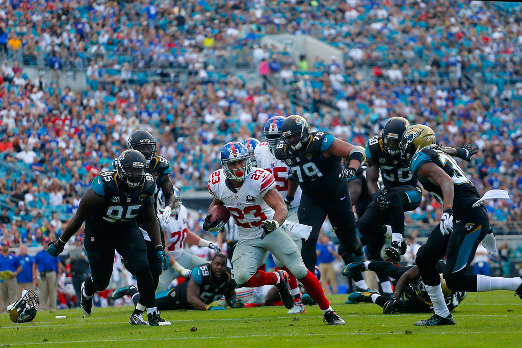 . JACKSONVILLE, FL - NOVEMBER 30:  Rashad Jennings #23 of the New York Giants runs the ball back for a touchdown in the second quarter against the Jacksonville Jaguars at EverBank Field on November 30, 2014 in Jacksonville, Florida.  (Photo by Chris Trotman/Getty Images) *** BESTPIX ***