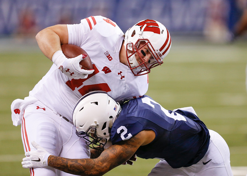 Wisconsin Badgers tight end Eric Steffes (44) is hit by Penn State Nittany Lions safety Marcus Allen (2) during the first half of the Wisconsin Badgers against the Penn State Nittnay Lions for the Big Ten football championship at Lucas Oil Stadium in Indianapolis, Ind., Saturday, Dec. 3, 2016. (Photo by Sam Riche)