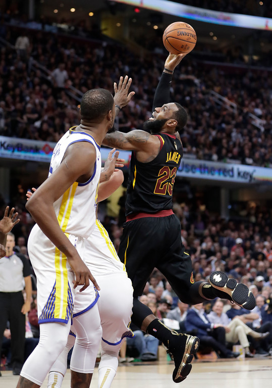 . Cleveland Cavaliers\' LeBron James shoots during the second half of Game 4 of basketball\'s NBA Finals against the Golden State Warriors, Friday, June 8, 2018, in Cleveland. (AP Photo/Tony Dejak)