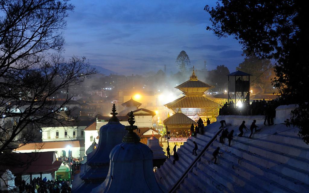 . Hindu devotees gather at dusk at the Pashupatinath temple during the Maha Shivaratri festival in Kathmandu on February 27, 2014.  AFP PHOTO/Prakash  MATHEMA/AFP/Getty Images