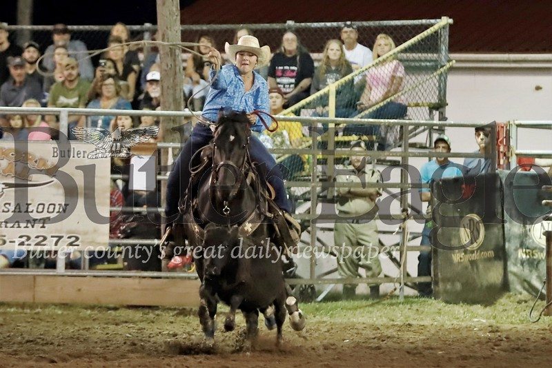 Morgan Slater of Slippery Rock tosses her rope in the women's cattle tieing competion Friday Night. Seb Foltz/Butler Eagle