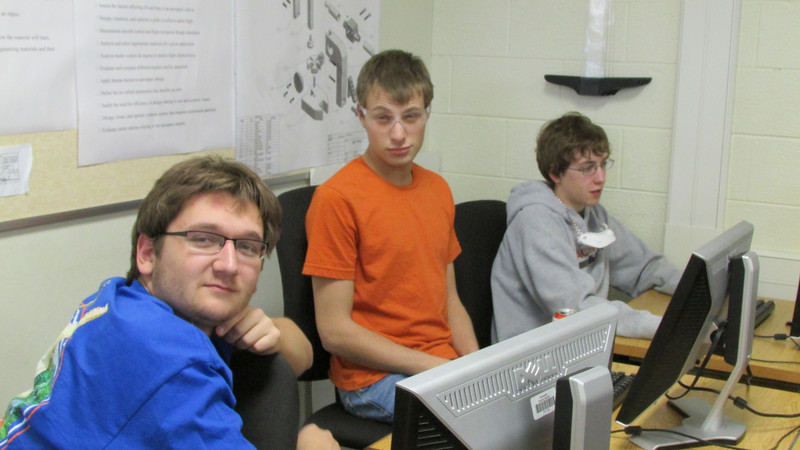 Justin, Adam, and Donald working on a prototype in CAD.