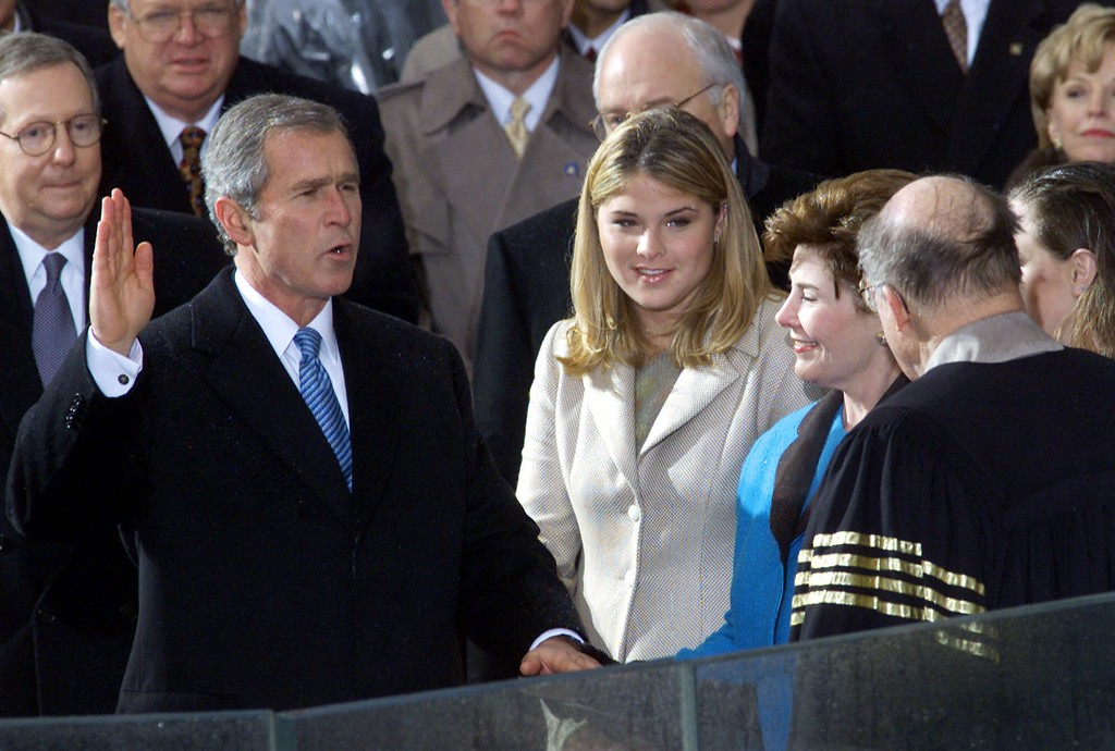 . George W. Bush takes the oath of office from Chief Justice William Rehnquist to become the 43rd president Saturday, Jan. 20, 2001, in Washington. Wife Laura Bush holds the Bible and daughter Jenna watches. (AP Photo/Doug Mills)