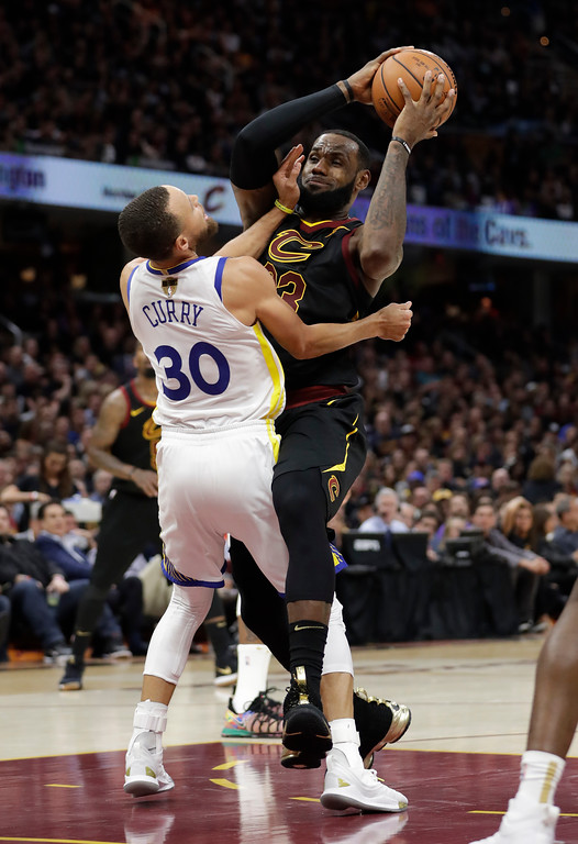 . Cleveland Cavaliers\' LeBron James is called for a charging foul against Golden State Warriors\' Stephen Curry during the second half of Game 4 of basketball\'s NBA Finals, Friday, June 8, 2018, in Cleveland. (AP Photo/Tony Dejak)