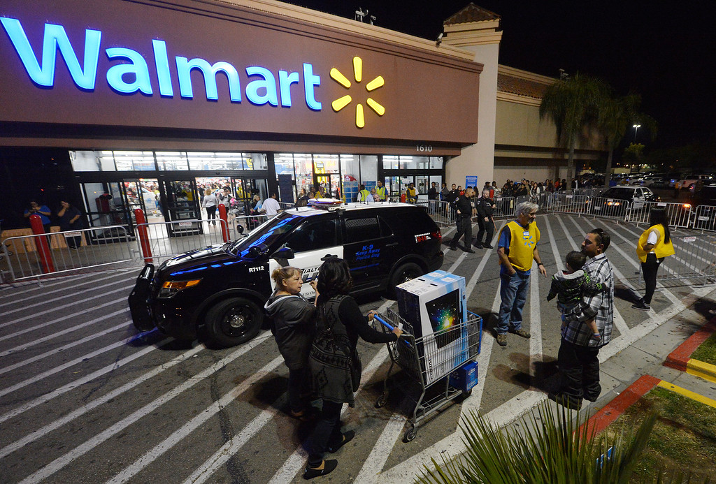 . Rialto police vehicles sit outside a Rialto Walmart Thursday night November 28, 2013 after 3 seperate altercations took place at the store Thursday night. Police officers descended on Walmart in Rialto after a brawl between two men injured a police officer who tried to break up the fight Thursday night. The injured officer was transported to St. Bernardine Medical Center in San Bernardino with a broken wrist, police officials said. A Walmart manager said the doors were originally scheduled to open at 8 p.m. but with the more than 3,000 people in line they made the decision to open the doors early, which police said led to the melee. Police said there were three fights total shortly after 7 p.m. at the store at 1610 S. Riverside Ave., two of which were inside over merchandise and the third outside that caused injury to the officer. (Will Lester/Inland Valley Daily Bulletin)