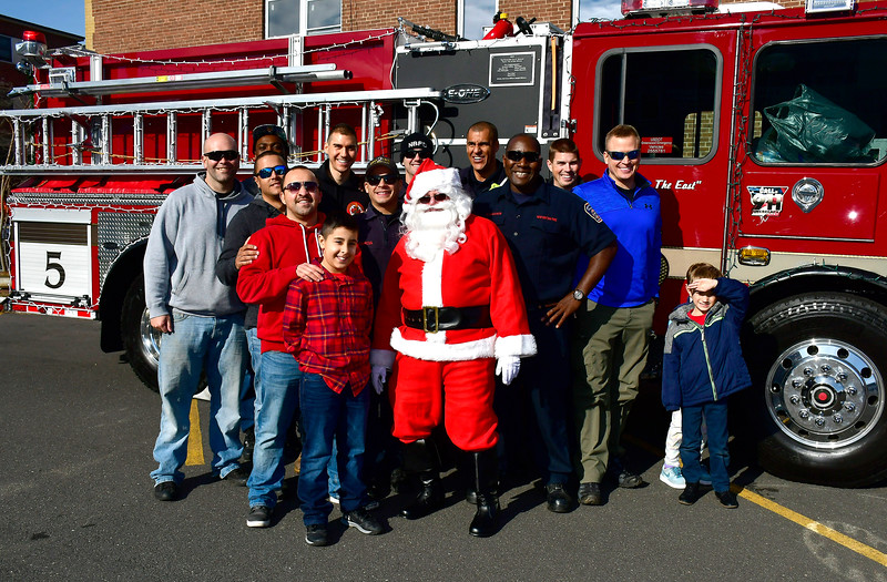 12/1/2018 Mike Orazzi | Staff Santa poses with volunteers during a fill a fire truck event at the New Britain Elks Lodge No. 957 with help from the New Britain Fire Department Saturday morning in New Britain. Items collected are to benefit the disabled veterans of New Britain and Newington.