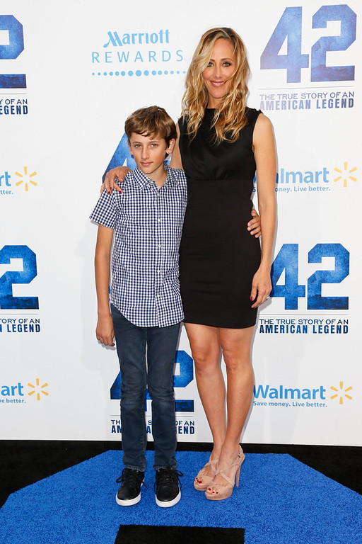 . Actress Kim Raver (R) and her son, Luke West Boyer, attend the premiere of Warner Bros. Pictures\' And Legendary Pictures\' \'42\' at TCL Chinese Theatre on April 9, 2013 in Hollywood, California.  (Photo by Imeh Akpanudosen/Getty Images)
