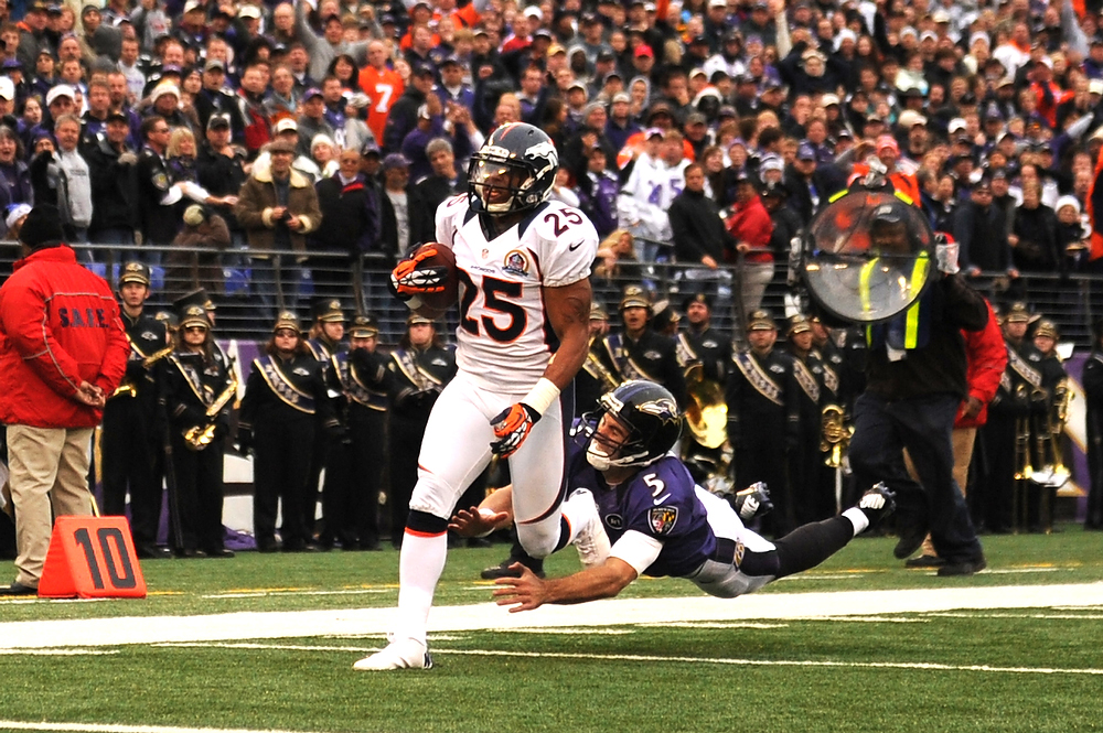 Description of . Denver Broncos cornerback Chris Harris #25 beats  Baltimore Ravens quarterback Joe Flacco #5 to the endzone for a touchdown in the first half against the Baltimore Ravens at the M&T Bank Stadium, in Baltimore , MD Sunday December 16, 2012.      Joe Amon, The Denver Post