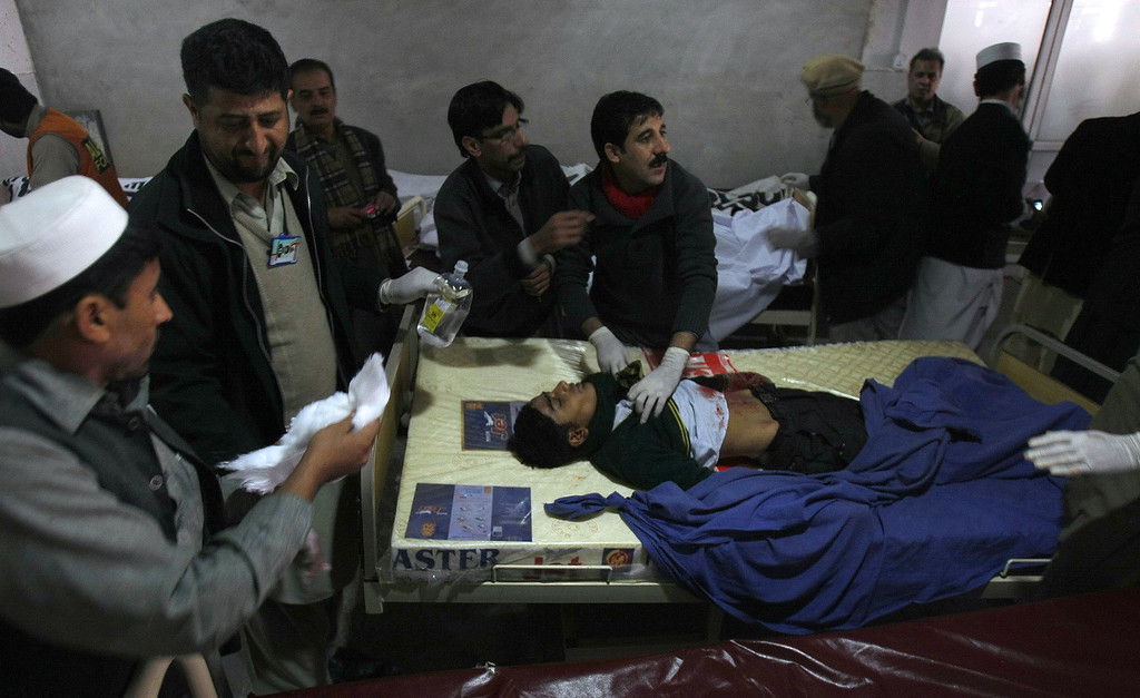 . An injured student receives treatment at a local hospital, after a Taliban attack on a school, in Peshawar, Pakistan, Tuesday, Dec. 16, 2014. Taliban gunmen stormed a military-run school in the northwestern Pakistani city of Peshawar on Tuesday, more than 100, most of them children, officials said, in the highest-profile militant attack to hit the troubled region in months. (AP Photo/Mohammad Sajjad)