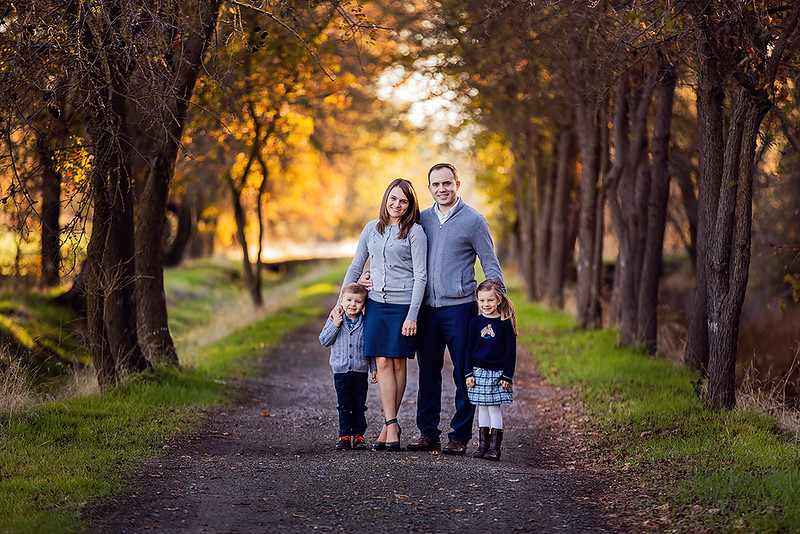 Sacramento family photographer during outdoor portrait session. Family portrait in Gibson Ranch Park.