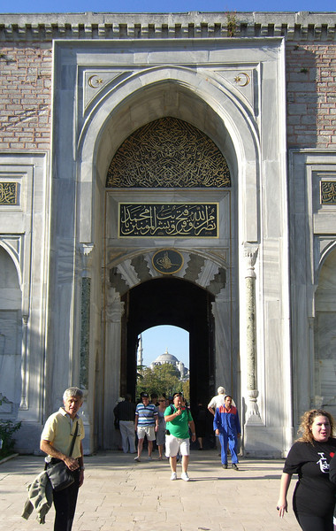 1-Topkapi, looking back through the Imperial Gate (entrance to the first courtyard). The Blue Mosque can be seen in the distance, through the archway.