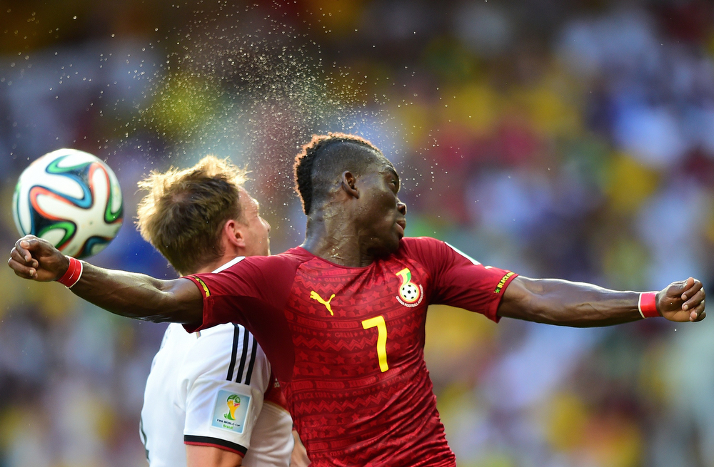 . Ghana\'s midfielder Christian Atsu Twasam (R) vies with Germany\'s defender Benedikt Hoewedes during a Group G football match between Germany and Ghana at the Castelao Stadium in Fortaleza during the 2014 FIFA World Cup on June 21, 2014.  (JAVIER SORIANO/AFP/Getty Images)