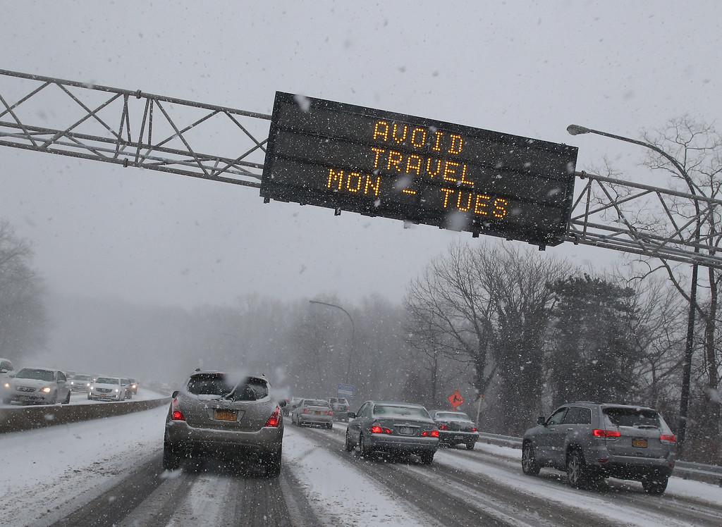 . NEW YORK, NY - JANUARY 26:  Overhead signs on the Long Island Expressway warn motorists of storm conditions on January 26, 2015 in the Queens borough of New York City. Much of the Northeast is bracing for a major winter storm which is expected to bring blizzard conditions and 10 to 30 inches of snow.  (Photo by Bruce Bennett/Getty Images)