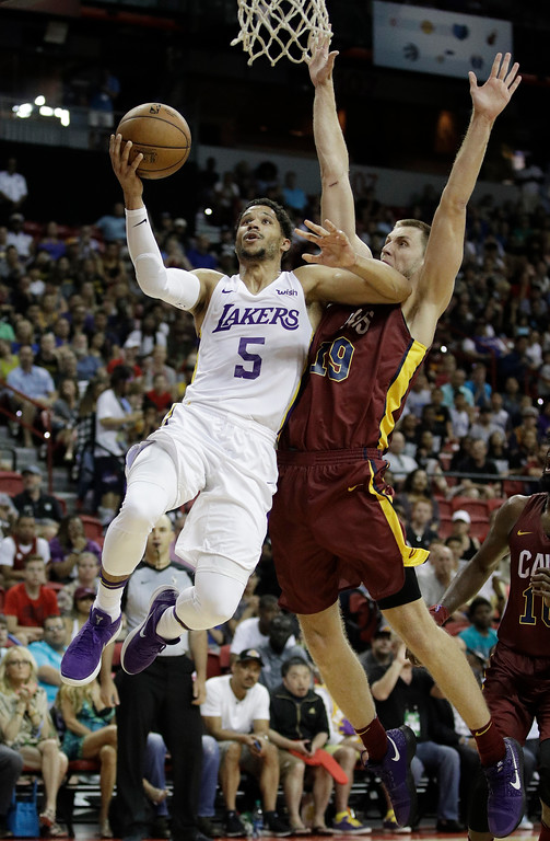 . Los Angeles Lakers\' Josh Hart shoots around Cleveland Cavaliers\' Vladimir Brodziansky during overtime of an NBA summer league basketball game, Monday, July 16, 2018, in Las Vegas. (AP Photo/John Locher)