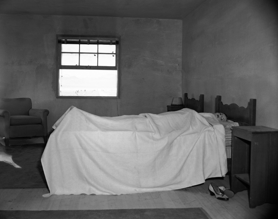 . Stretched on a bed, in an upstairs bedroom of house number two, is a mannequin ready to test the effects of an atomic explosion at the atomic proving grounds near Las Vegas, Nev., March 15, 1953. Thorough the window a mile and a half away stands a 300 foot steel tower atop which the bomb will be detonated. The purpose of the test blast is to show Civil Defense officials what would happen in an American city if it were subjects to a atomic attack. (AP Photo/Dick Strobel)