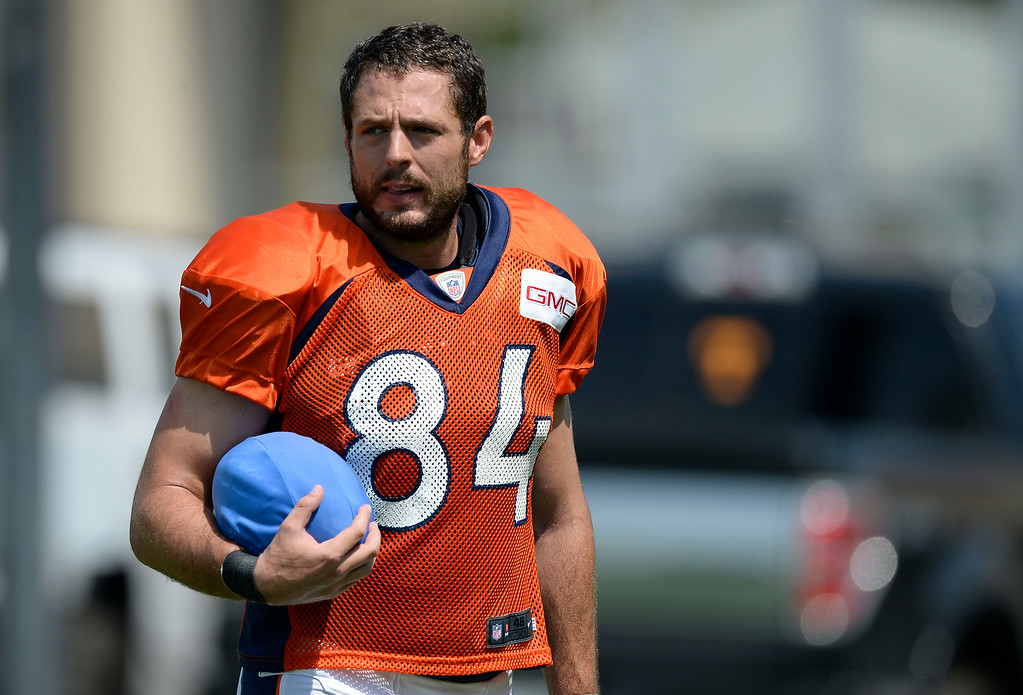 . Denver Broncos tight end Jacob Tamme (84) carries the blue football on day five of the Denver Broncos 2014 training camp July 28, 2014 at Dove Valley. (Photo by John Leyba/The Denver Post)