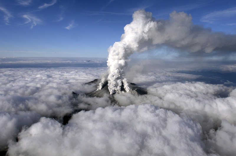 . Dense white plumes rise high in the air as Mt. Ontake erupts in central Japan, Saturday, Sept. 27, 2014. With a sound likened to thunder, the 3,067-meter (10,062-foot) mountain spewed large white plumes high into the sky, sending people fleeing, covering surrounding areas in ash and trapping more than 250 climbers. (AP Photo/Kyodo News)
