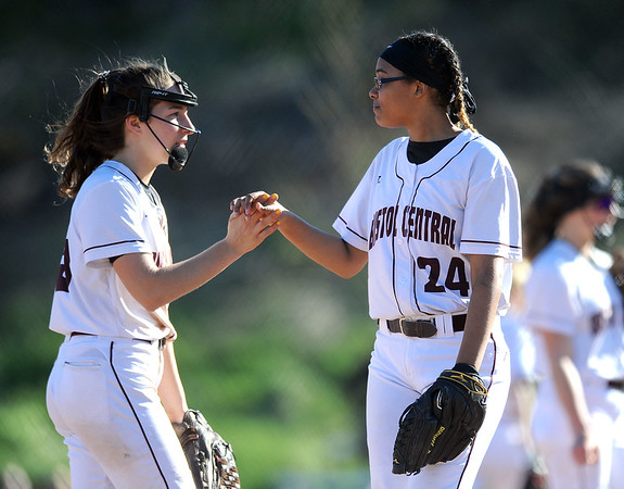 4/24/2019 Mike Orazzi | Staff Bristol Central's Gwen Torreso (15) and Janessa Bartell (24) during Wednesday's softball with Simsbury in Bristol.