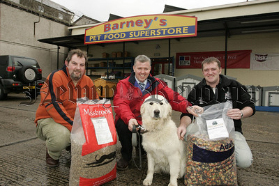 "Pictured centre is Stephen Rooney from mayobridge with his dog ""Lucy"" who have won a yaers supply of dog food as part of a customer competition at Barney's Pet Food Superstore. Also pictured are Jon Binley from Massbrook Pet Foods and Manager of Barney's Malachy Havern. 07W4N2"