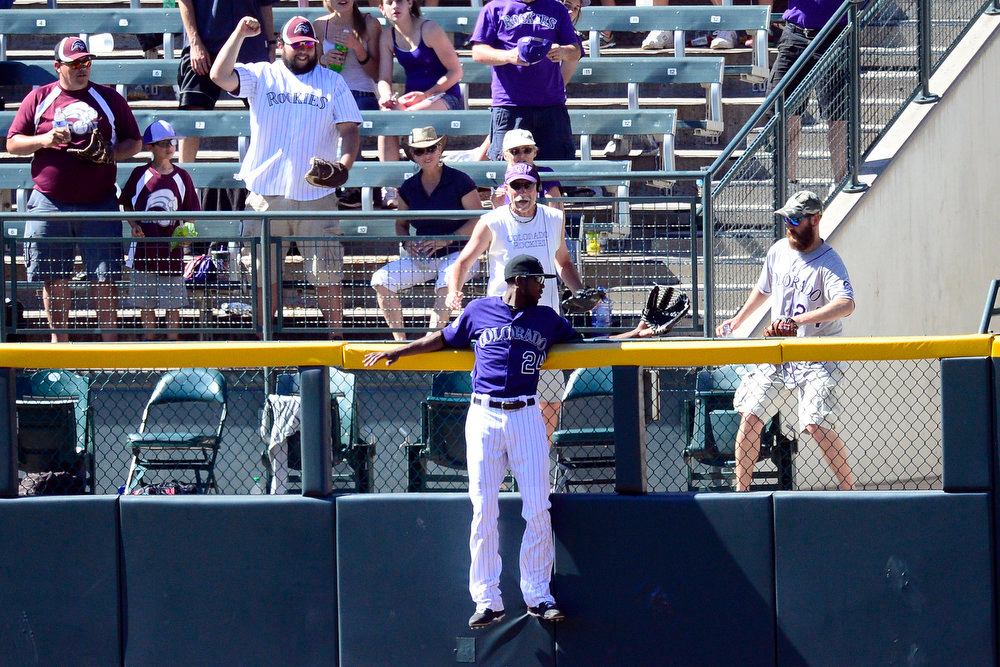 . Colorado Rockies center fielder Dexter Fowler (24) cannot make a lead-saving catch on a tw0-run home run by pinch hitter San Diego Padres left fielder Mark Kotsay (14) during the action in Denver. The Colorado Rockies hosted the San Diego Padres at Coors Field on Sunday, June 9, 2013. (Photo by AAron Ontiveroz/The Denver Post)