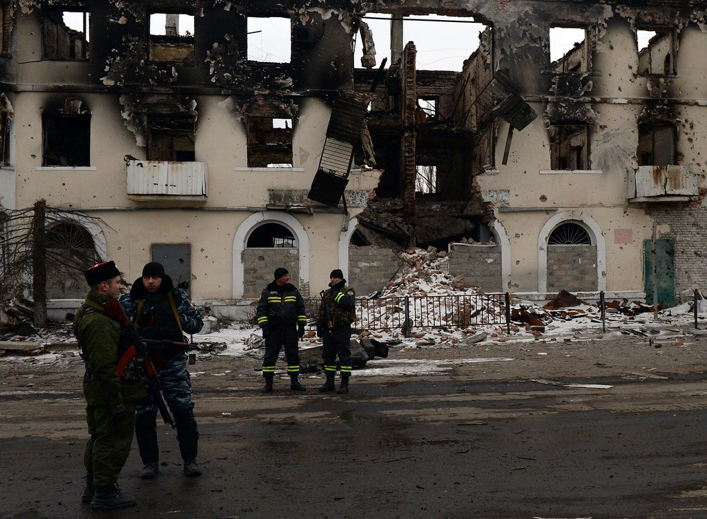 . Armed pro-Russian rebels stand near a partially collapsed building in Uglegorsk, 6 kms southwest of Debaltseve, on February 19, 2015. More than 90 Ukrainian troops were captured and 82 were still missing after pro-Russian rebels seized the key town of Debaltseve, Ukraine\'s army said today. AFP PHOTO / VASILY MAXIMOVVASILY MAXIMOV/AFP/Getty Images