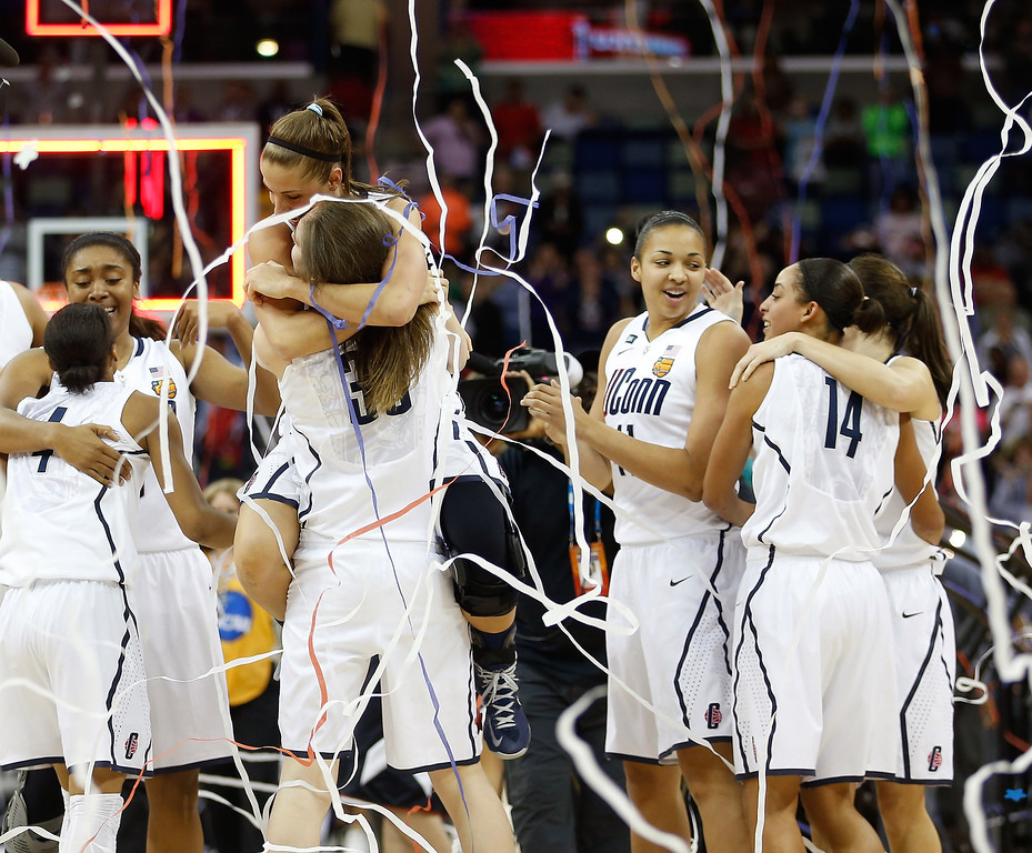 . The Connecticut Huskies celebrate after defeating the Louisville Cardinals during the 2013 NCAA Women\'s Final Four Championship at New Orleans Arena on April 9, 2013 in New Orleans, Louisiana.  (Photo by Chris Graythen/Getty Images)