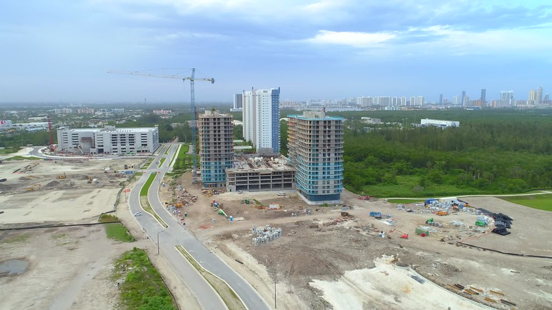 Aerial footage group of buildings under construction 4k approach
