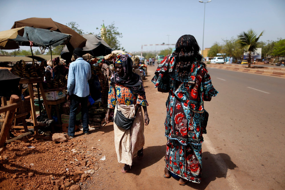 Description of . Women are seen at the market in the Malian capital of Bamako February 7, 2013. REUTERS/Benoit Tessier