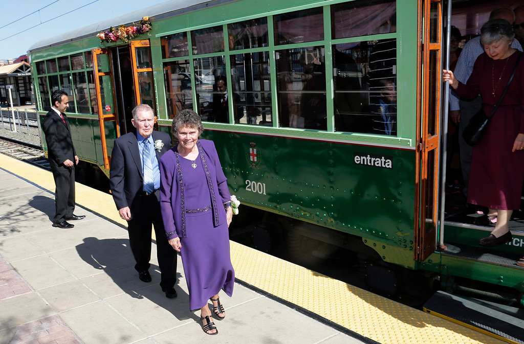 . Ralph and Mary Lou Watkins arrive at the Light Rail platform at the Diridon Station as they celebrate their 60th wedding anniversary on Valentine\'s Day aboard a Santa Clara Valley Transportation Authority historic trolley in San Jose, Calif. on Thursday, Feb. 14, 2013. Ralph, 82, and Mary Lou, 79, won an essay contest sponsored by the VTA to have the opportunity to renew their vows on historic trolley, Car 2001. The couple held a private ceremony aboard the trolley and held a brief reception on the VTA Light Rail platform.  (Gary Reyes/ Staff)
