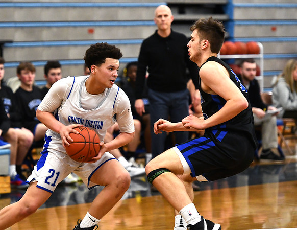 2/18/2020 Mike Orazzi | StaffrBristol Eastern High School's Trint Otero (21)and Tolland's Tim Restall (35) in Bristol on Tuesday night.