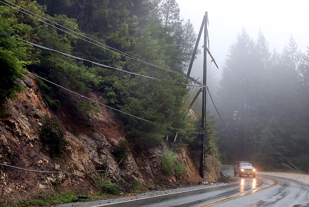 . A utility pole along Empire Grade Road was destroyed when a tree branch fell across power lines Thursday morning, Dec. 11, 2014, in Bonny Doon. (Shmuel Thaler -- Santa Cruz Sentinel)