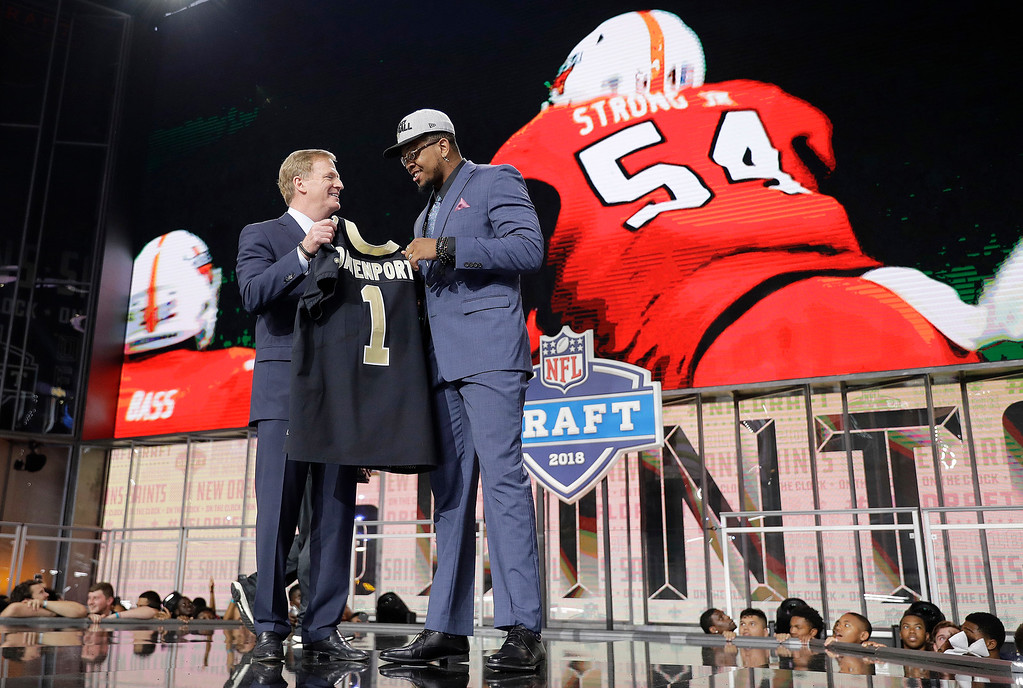 . Commissioner Roger Goodell, left, presents UTEP\'s Marcus Davenport with his New Orleans Saints jersey during the first round of the NFL football draft, Thursday, April 26, 2018, in Arlington, Texas. (AP Photo/David J. Phillip)