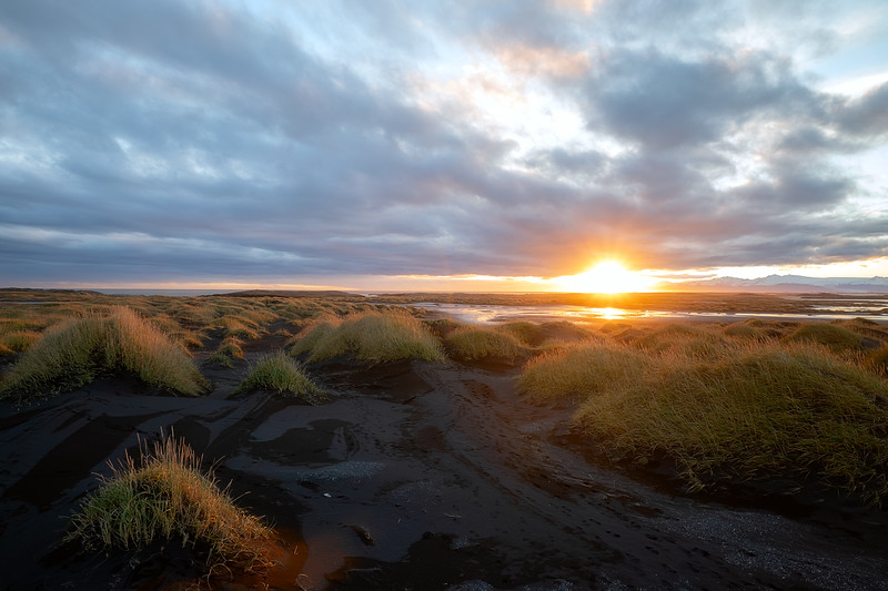 Sunset on the black dune beack of Stokksnes