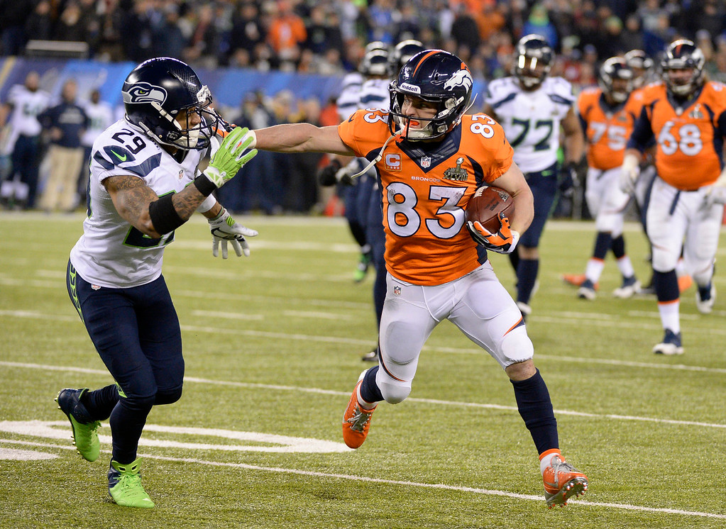 . Denver Broncos wide receiver Wes Welker (83) runs with the ball chased by Seattle Seahawks free safety Earl Thomas (29) during the third quarter. The Denver Broncos vs the Seattle Seahawks in Super Bowl XLVIII at MetLife Stadium in East Rutherford, New Jersey Sunday, February 2, 2014. (Photo by John Leyba/The Denver Post)