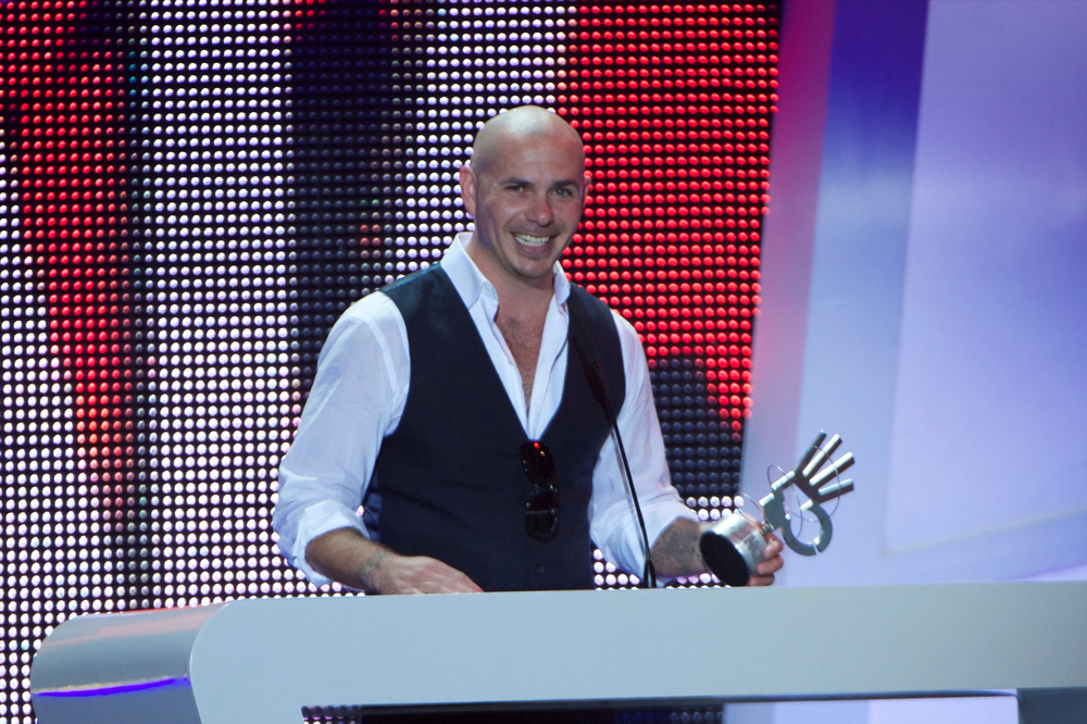 ". Pitbull receives the ""40 Principales\"" award during \'40 Principales Awards\' 2012 at Palacio de los Deportes on January 24, 2013 in Madrid, Spain.  (Photo by Carlos Alvarez/Getty Images)"