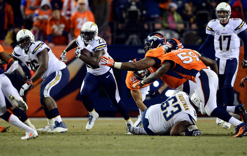 . San Diego Chargers running back Ronnie Brown (23) gains yards during the second half.  The Denver Broncos vs. the San Diego Chargers at Sports Authority Field at Mile High in Denver on December 12, 2013. (Photo by AAron Ontiveroz/The Denver Post)