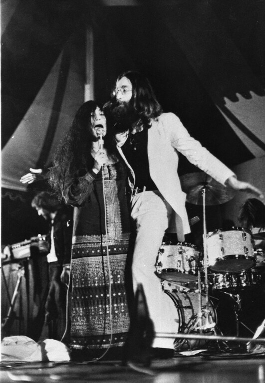 . John Lennon and his wife Yoko Ono perform in their first public appearance as the Plastic Ono Band, at Toronto\'s Varsity Stadium, Sept. 14, 1969.  (AP Photo)