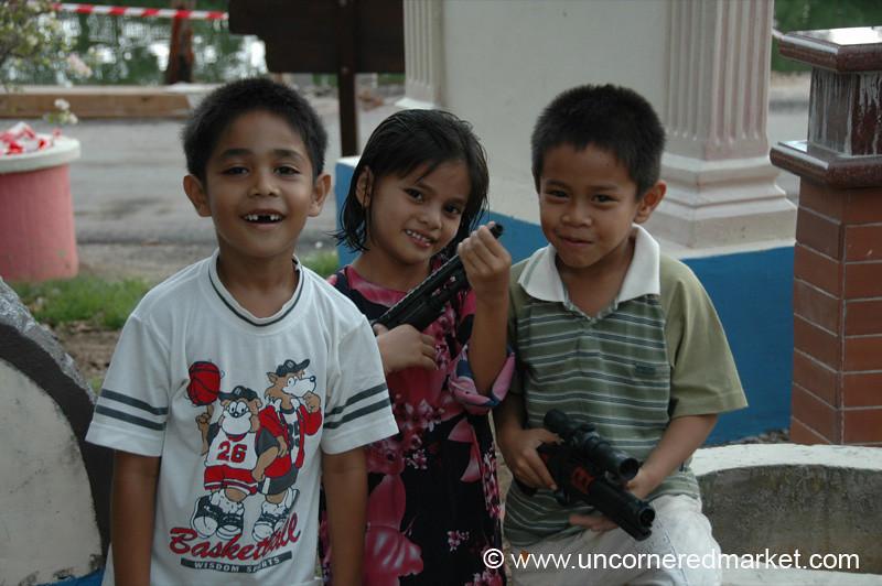 Malaysian Kids with Toy Gun - Melaka, Malaysia