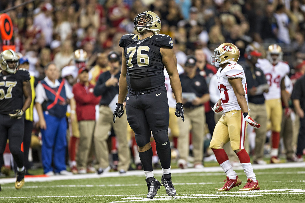 . Akiem Hicks #76 of the New Orleans Saints after making a big tackle against the San Francisco 49ers at  Mercedes-Benz Superdome on November 17, 2013 in New Orleans, Louisiana.  The Saints defeated the 49ers 23-20.  (Photo by Wesley Hitt/Getty Images)