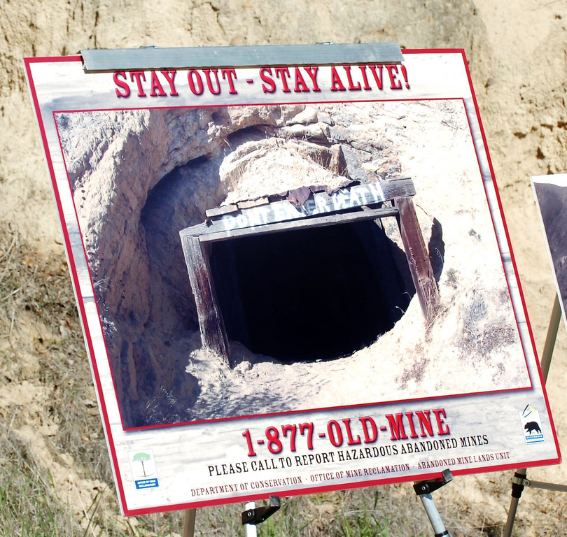 ". A sample poster from the national ""Stay Out, Stay Alive\"" public awareness campaign about the dangers of abandoned mines stands during a press conference at the entrance to the abandoned Tesla sand mine in the Carnegie State Vehicular Recreational Area, 12 miles southeast of Livermore, on Wednesday, January 16, 2008. The California Department of Conservation\'s Office of Mine Reclamation is permanently sealing the Tesla sand mine as part of a statewide effort to seal mine sites that are hazardous to the public. Every year people are injured or killed at one of the approximately 47,000 abandoned mines in the state of California. (Gina Halferty/Tri-Valley Herald)"