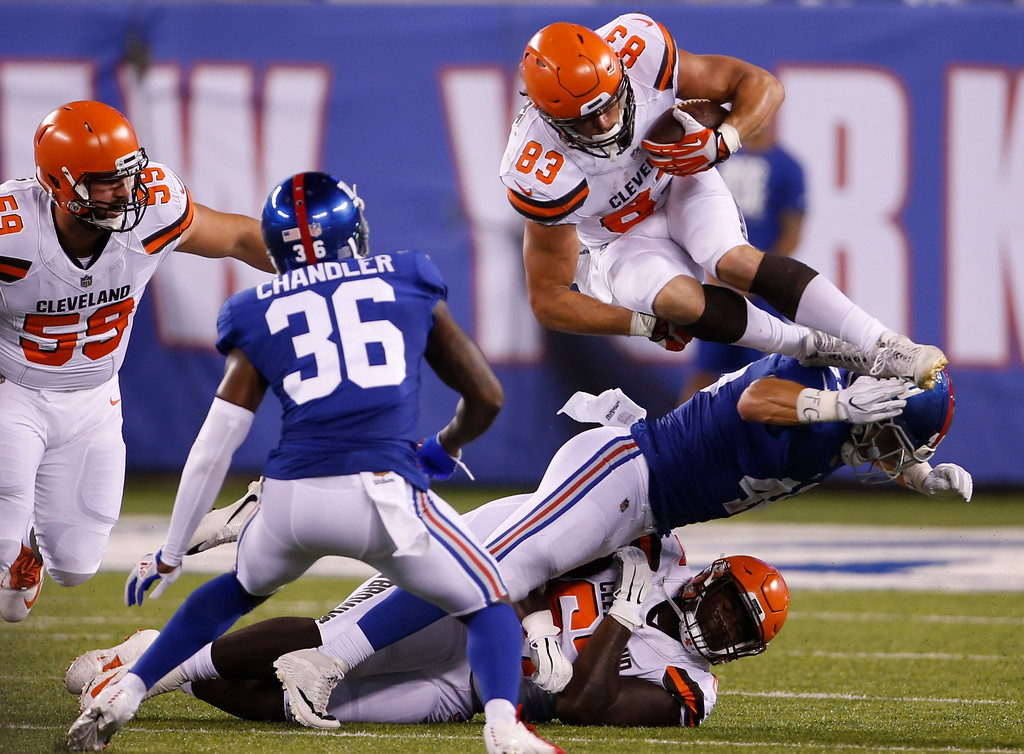 . Cleveland Browns Devon Cajuste (83) is tackled by New York Giants\' Calvin Munson during the second half of a preseason NFL football game Thursday, Aug. 9, 2018, in East Rutherford, N.J. (AP Photo/Adam Hunger)