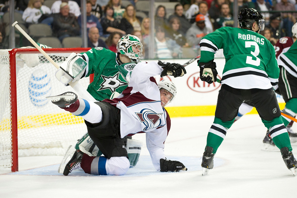 . DALLAS, TX - NOVEMBER 1:  Andre Benoit #61 of the Colorado Avalanche is tripped up by Kari Lehtonen #32 of the Dallas Stars on November 1, 2013 at the American Airlines Center in Dallas, Texas.  (Photo by Cooper Neill/Getty Images)