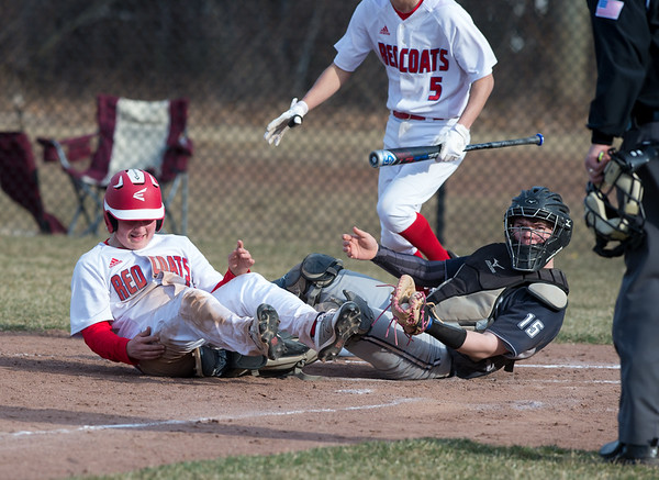 04/04/19 Wesley Bunnell | Staff Berlin baseball defeated Wethersfield at Sage Park on Thursday afternoon. Jeffrey Kuzoian (11) gets tangled with the catcher on a close play at home.
